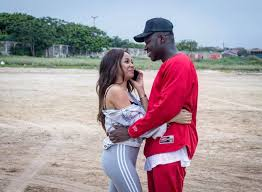 Medikal and Sister Derby almost 'making love' on the sofa (video)