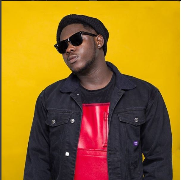 Medikal poses in front of his new Mansion for the first time
